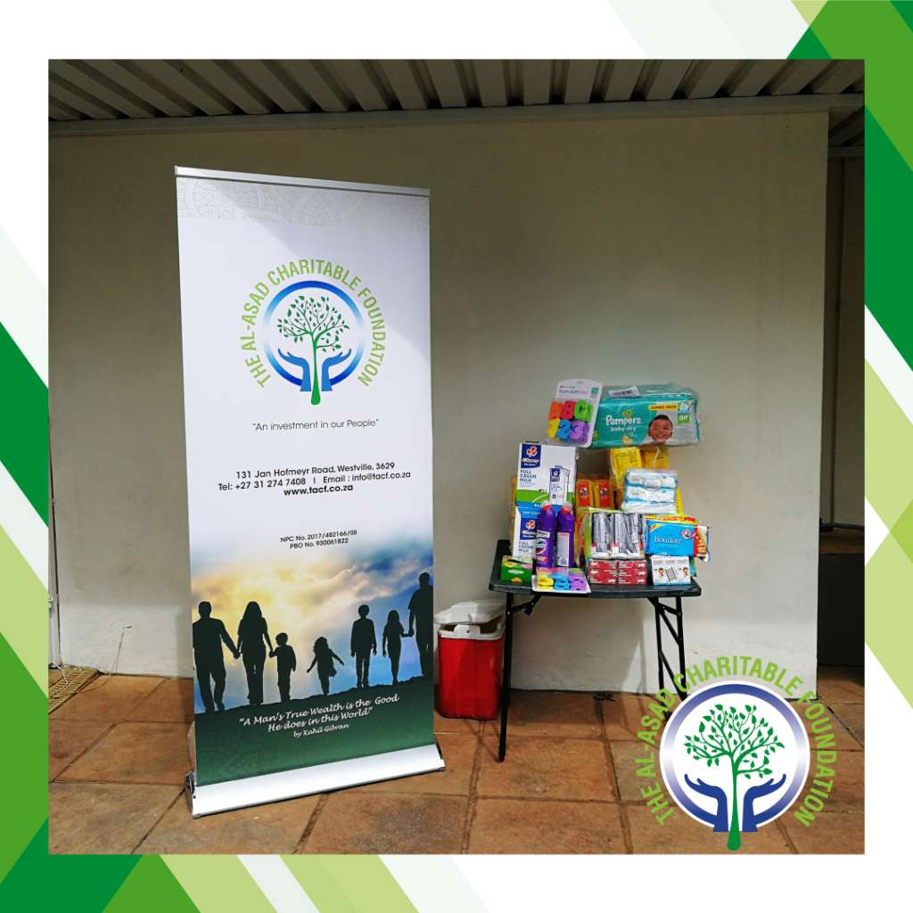 Some of the The Al-Asad Chartiable Foundation donation to The Baby Home - Durban North with The Al-Asad Charitable Foundation banner