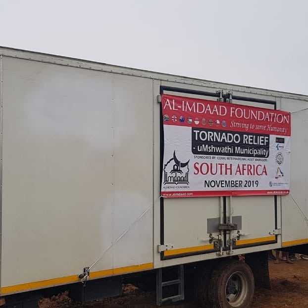 Truck with banner of the charitable cause
